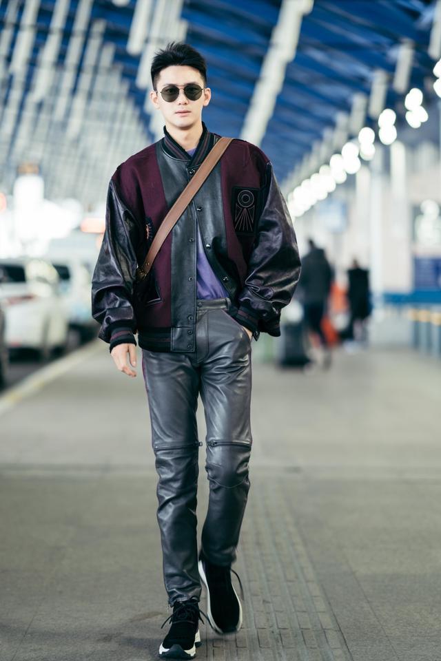 熊梓淇复古摩登造型现身机场启程纽约时装周
