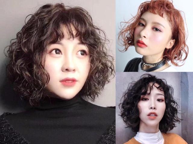 外翘设计的短发发型,是今年最流行的一款,由于脸部两边的头发把脸蛋